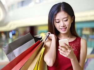 Woman using apps on her free cell phone for black friday shopping