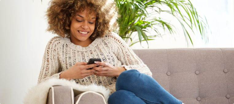 woman enjoying 5g nationwide coverage on americas largest mobile network q link wireless, free phone service with q link wireless